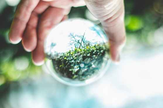 close up photo of person holding lensball